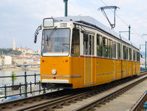 Historic yellow tram on the street of the Budapest, Hungary Royalty Free Stock Photo