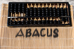 Historical abacus. With lettering on bamboo mat Royalty Free Stock Images