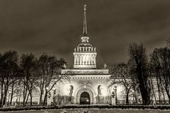 Historical Admiralty buildingl landmark Petersburg night. Landmark in St Petersburg, Russia: historical Admiralty building by winter night with park and trees in Stock Photo