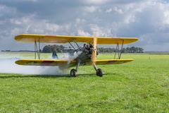 Historical airplane with pilot is ready to take off Royalty Free Stock Photography