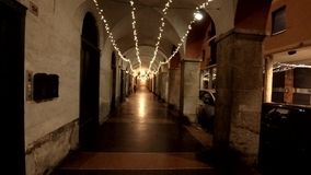 An historical arcade during Christmas time in the night. An historical alley during Christmas time . Night lights . Historical buildings stock video
