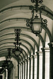 Historical alley with lanterns and archways at Praca do Comerci Stock Photo