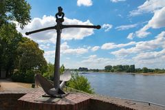 Historical anchor on River Rhine in Dusseldorf Kaiserswerth, Germany royalty free stock images
