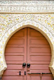 Historical in  antique  door morocco style africa    rusty. Historical in  antique building door morocco style africa   wood and metal rusty Royalty Free Stock Photos