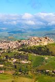 Historical Arab village Calascibetta on the top of the hills in Sicily, Italy. Taken with nearby mountains and green landscape. Photographed from Enna. Norman stock image