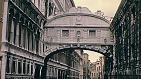 Venice Ponte dei Sospiri. Historical archive footage of Venice narrow canals and its small historic bridges through the alleys of the town. Detail of romantic stock video