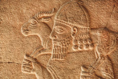 Historical Assyrian relief of farmer with goat Royalty Free Stock Images