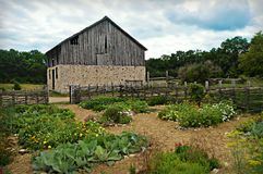 Historical Barn with Flower Garden Royalty Free Stock Images