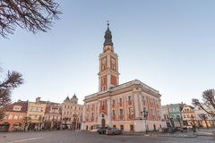 LESZNO, POLAND - FEBRUARY 16, 2019. Baroque town hall at the Old Market with a sunny blue sky background stock photos