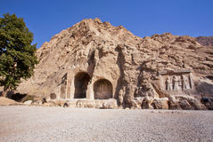 Historical bas-relief in ancient Arches of Taq-e Bostan from the era of Sassanid Empire of Persia. Taq-e Bostan is a site with large rock relief from the era Royalty Free Stock Image
