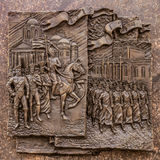 Historical bas-relief in Belgorod the obelisk of military glory, depicting soldiers going for the war in 1812 and 1914 Royalty Free Stock Photos