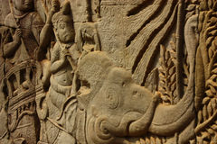 Historical Bas Relief depicting ancient Khmer warriors in formation and doing battle, Siem Reap Stock Image
