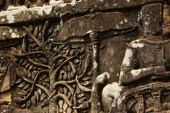 Historical Bas Relief depicting ancient Khmer warriors in formation and doing battle, Siem Reap Royalty Free Stock Images