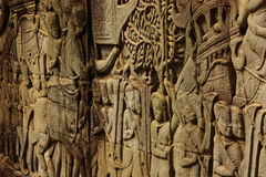 Historical Bas Relief depicting ancient Khmer warriors in formation and doing battle, Siem Reap Royalty Free Stock Photography