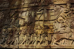 Historical Bas Relief depicting ancient Khmer warriors in formation and doing battle, Siem Reap Royalty Free Stock Image