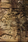 Historical Bas Relief depicting ancient Khmer warriors in formation and doing battle, Siem Reap Royalty Free Stock Photo