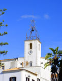 The historical bell tower of Torre de Relogio in Albufeira Stock Photography