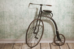 Historical bicycle by the wall Royalty Free Stock Photo