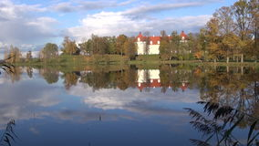 Historical Birzai castle and Sirvena lake in autumn, Lithuania Royalty Free Stock Images