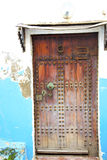 Historical blue  in  antique      style africa   wood  rusty. Historical in     antique building door morocco      style africa   wood and metal rusty Stock Image