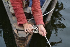 Historical boat. Historic wooden boat. Moorings and hands Stock Photography