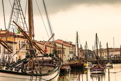 Historical boats in canal port of Cesenatico. Historical boats moored in the canal port of Cesenatico stock images