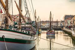 Historical boats in canal port of Cesenatico. Historical boats moored in the canal port of Cesenatico stock photos