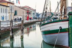 Historical boats in canal port of Cesenatico. Historical boats moored in the canal port of Cesenatico royalty free stock images
