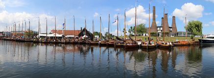 Historical botters in a line-up in the port of Huizen royalty free stock images