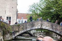 Historical Bridge Bruges Belgium. The facade of the historical brick houses next to a water channel and a bridge in Bruges, Belgium Stock Photo