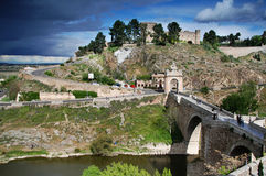 Historical Bridge in Toledo with dark clouds. Bridge over the Tagus river in Toledo, Spain stock photo