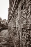 Historical buddhist temple stone carvings. Black and white picture of Borobudur temple carvings in passway on Java, Indonesia Royalty Free Stock Photography