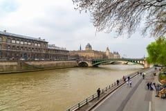 Historical buidlings along the river Seine in Paris, France. Tribunal de Commerce, Conciergerie, Pont Notre Dame bridge. Paris, France - 23 March 2019 royalty free stock images