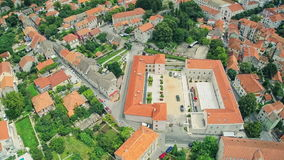 Historical building Alkarski Dvori in Sinj, aerial. SINJ, CROATIA - August 3, 2014: Copter aerial ascent view of the building Alkarski Dvori. Memorial center of stock video