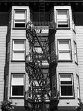 Historical building detail with fire escape stairs - Black and white. Historical building detail with fire escape stairs - symmetrical composition - Black and Stock Image