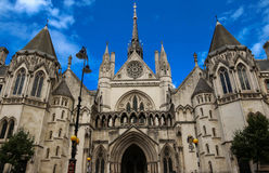 Historical building and entrance of Royal Courts of Justice in London ,England. Stock Photos