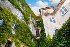 Historical building with green plant vegetation. In Eze Village, Royalty Free Stock Photo