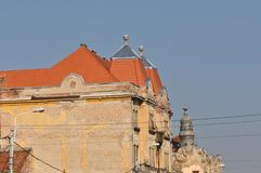 Historical building. With restored roof and deteriorated walls Royalty Free Stock Photo