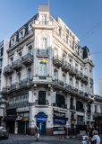 Historical Building Montevideo Uruguay. The facade of a historical building with iron fence balconies on a corner of Ciudad Vieja, downtown Montevideo, Uruguay Stock Photo