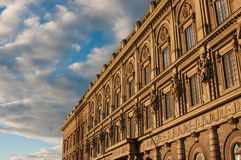 Historical building in Stockholm. Photo of a highly decorated historical building in Stockholm taken from under and showing the blue sky with grey clouds Royalty Free Stock Images