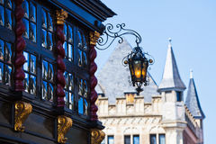 Historical buildings in Aachen, Germany. Old crown glass window with an antique lantern at a historical house in the old town of Aachen, Germany. A further Stock Photography