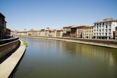Historical buildings along the river Arno in Pisa Stock Photos