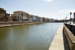 Historical buildings along the river Arno in Pisa Stock Photo