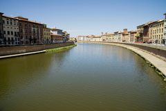 Historical buildings along the river Arno in Pisa Stock Image