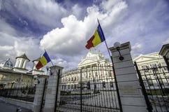 Bucharest Romania. Coltea hospital in Bucharest with the romanian flag Royalty Free Stock Photos
