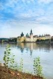 Historical buildings and Charles Bridge in Prague Royalty Free Stock Images