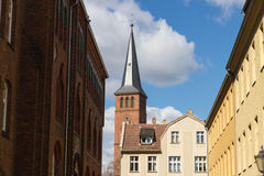 Historical buildings and a church steeple in a German old town Stock Images