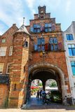 Historical buildings with city gate in the center of Nijmegen, Netherlands. Nijmegen, Netherlands May 21, 2018: historical buildings with city gate in the center stock photography
