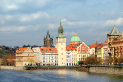 Historical buildings in Prague from across the river u Royalty Free Stock Photography