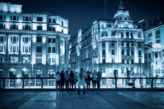 Historical buildings in shanghai at night. Excellent historical buildings and tourists in shanghai bund at night Stock Photography